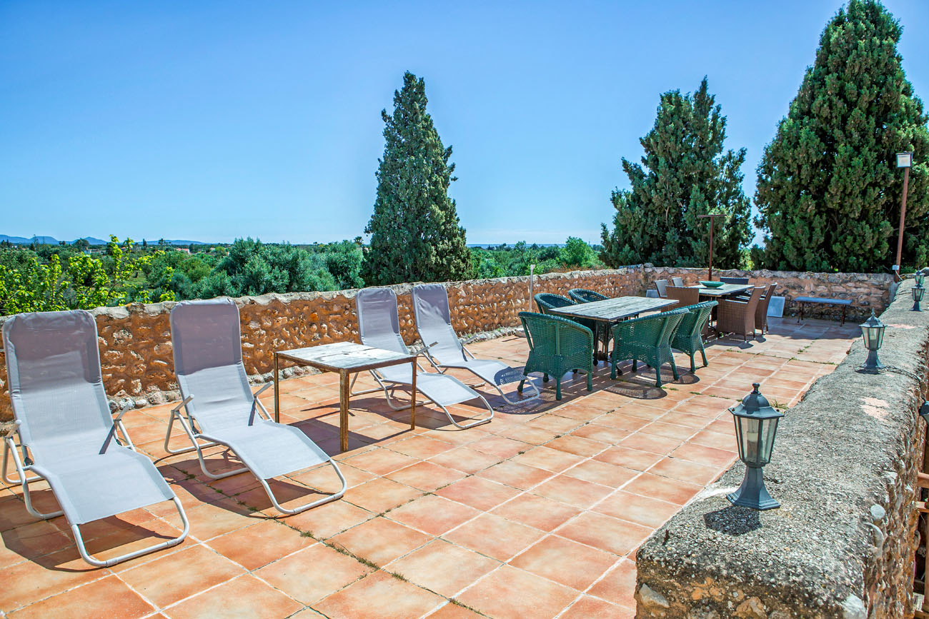 1ST FLOOR FRONT TERRACE, DINING AND SUN BATHING AND FLIGH OF STAIRS TO THE WALLED COURTYARD